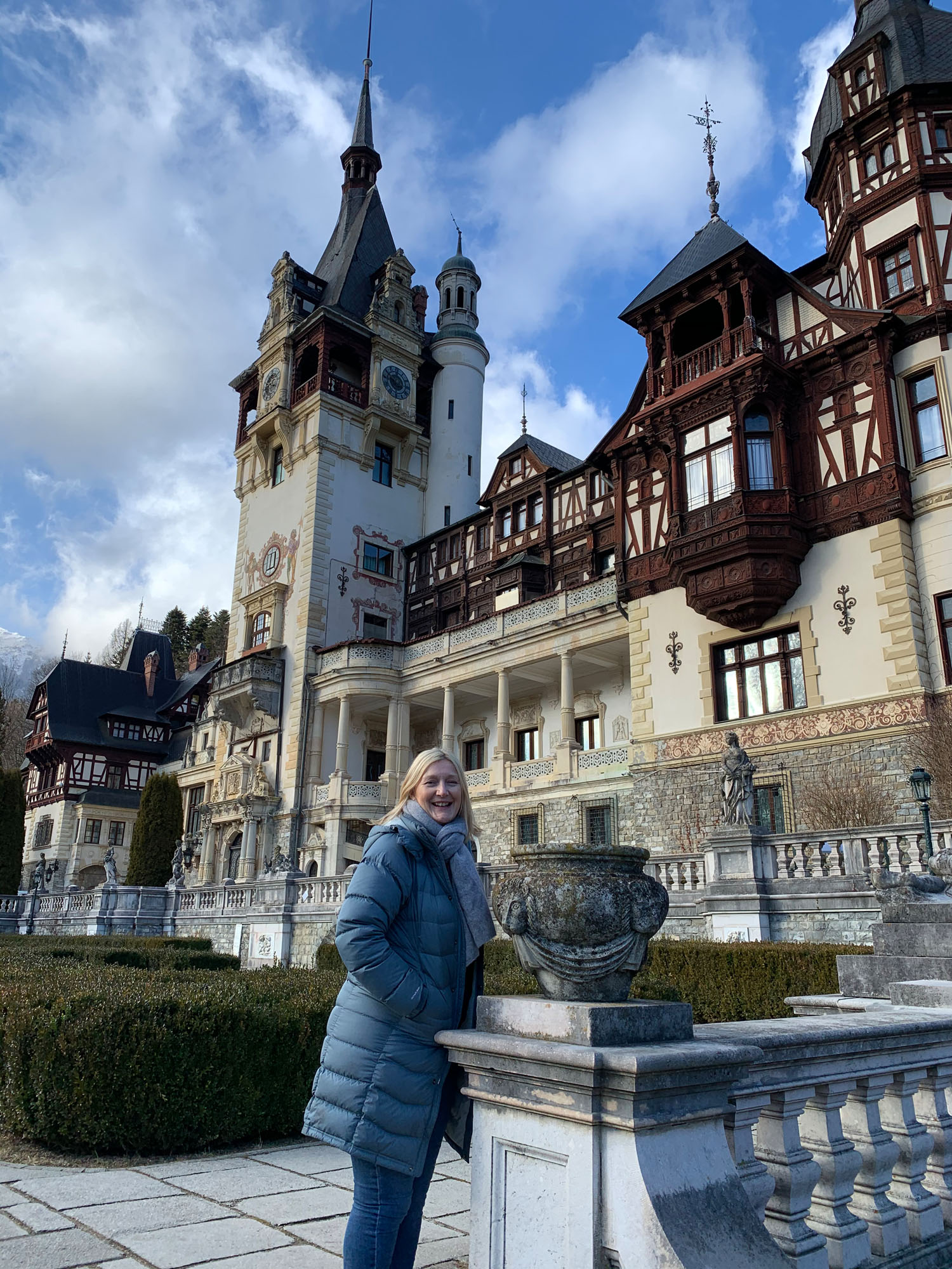 Philippa strikes a pose in front of Peleș Castle, Romania.