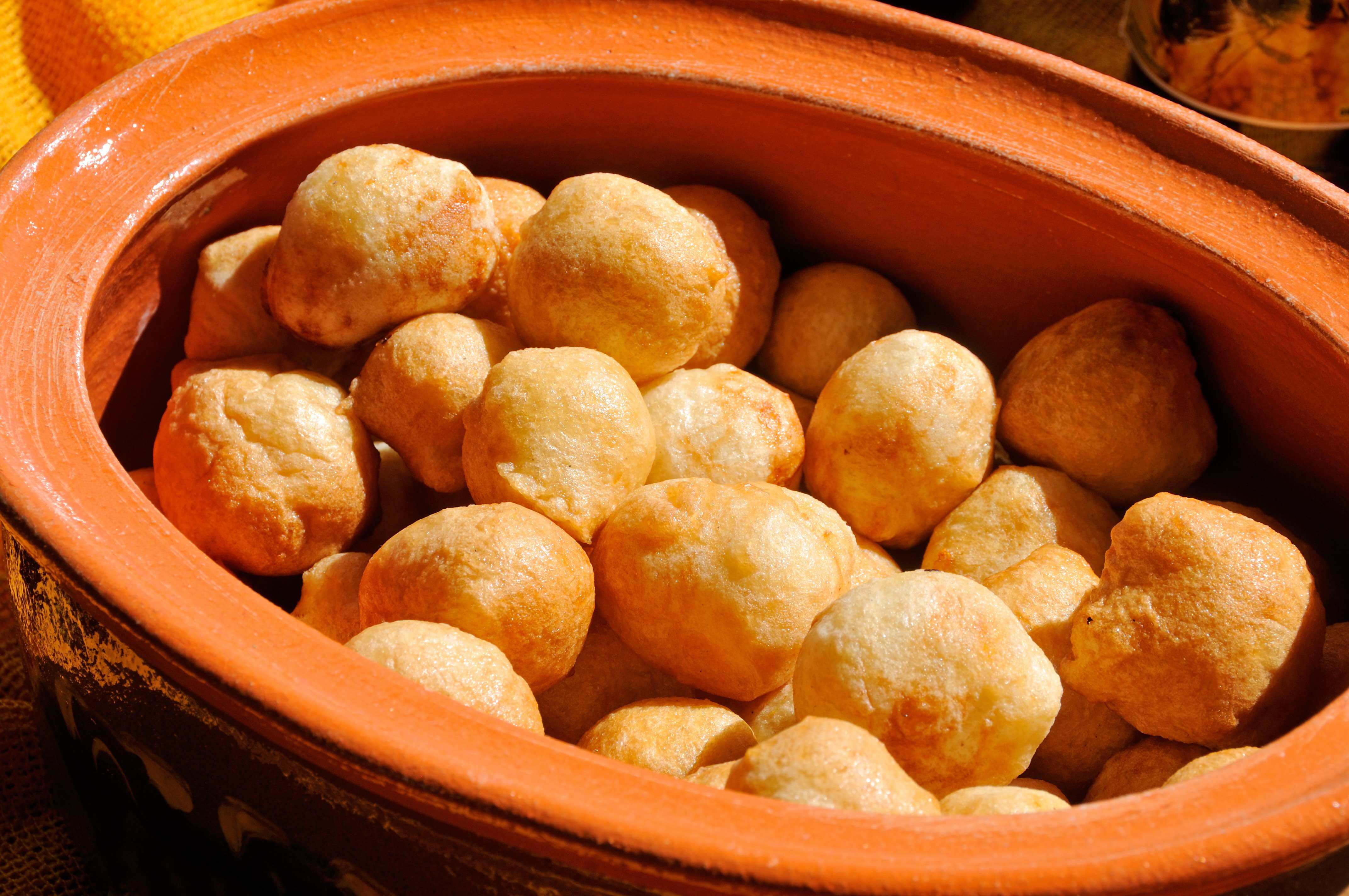 Popular local snack priganice, which is served either savoury or sweet, with fresh local cheese, honey, or jam.