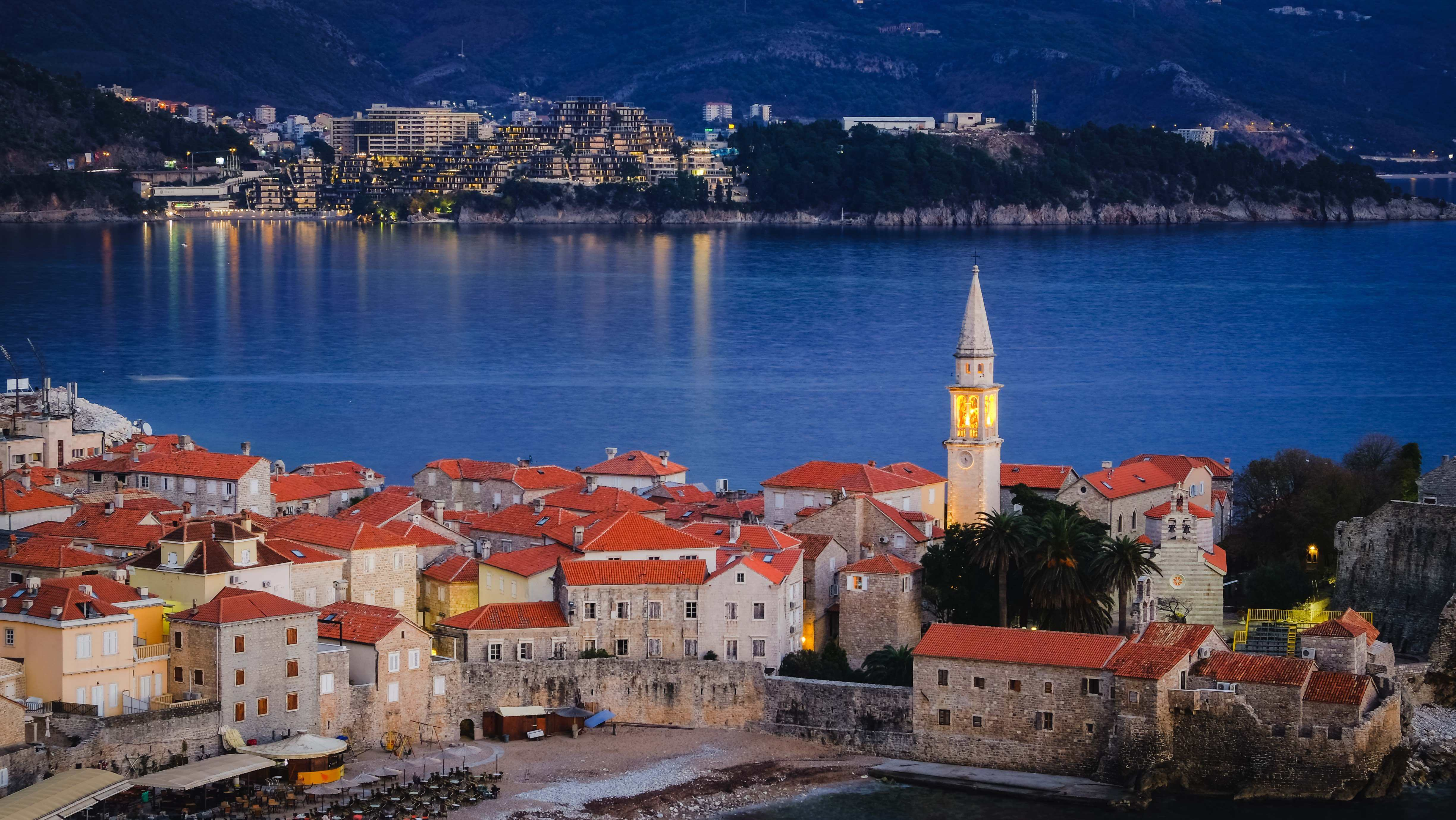 A stunning night view of the lively old town in Budva.
