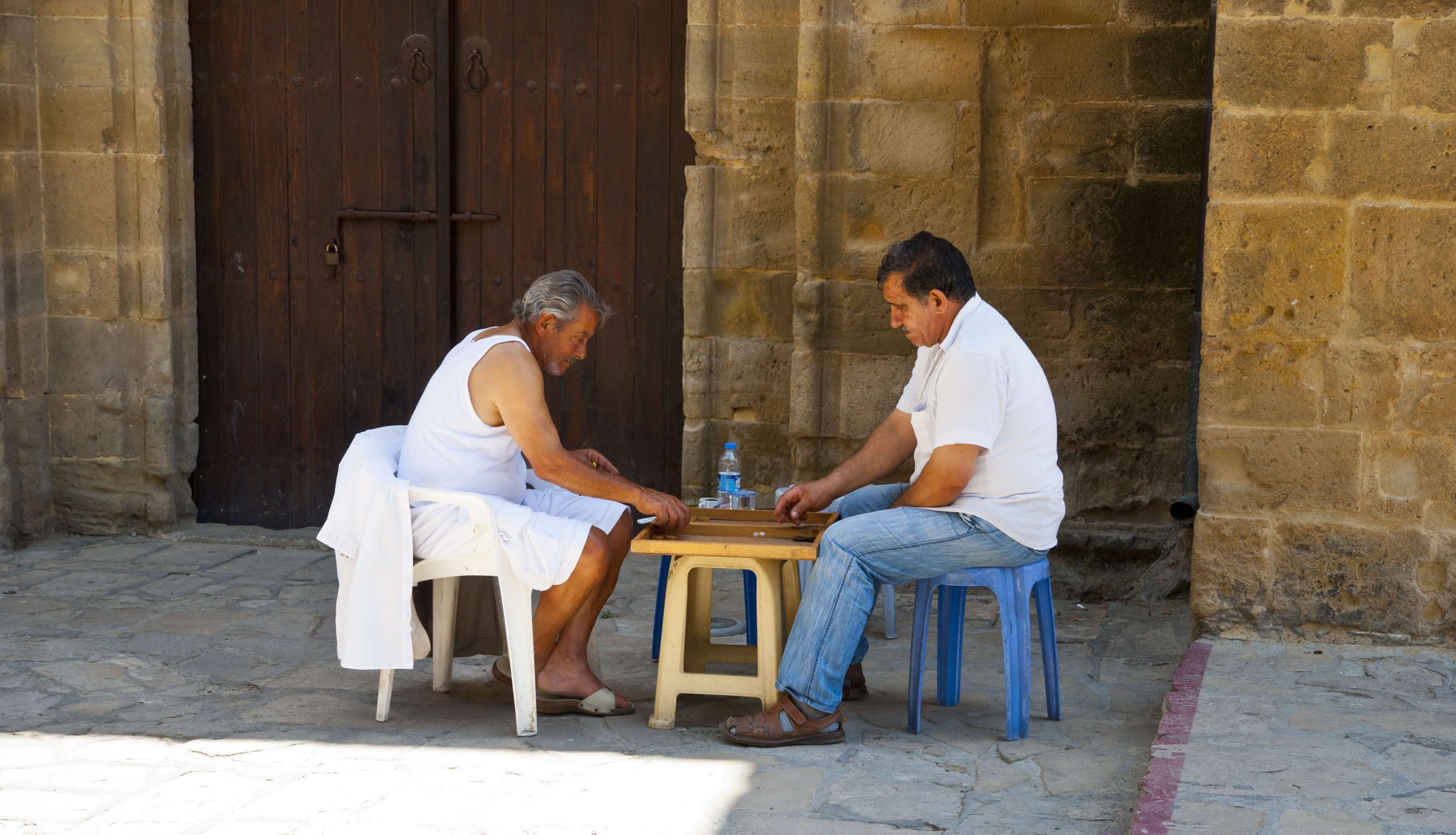 Locals in Northern Cyprus meet for a game of backgammon.