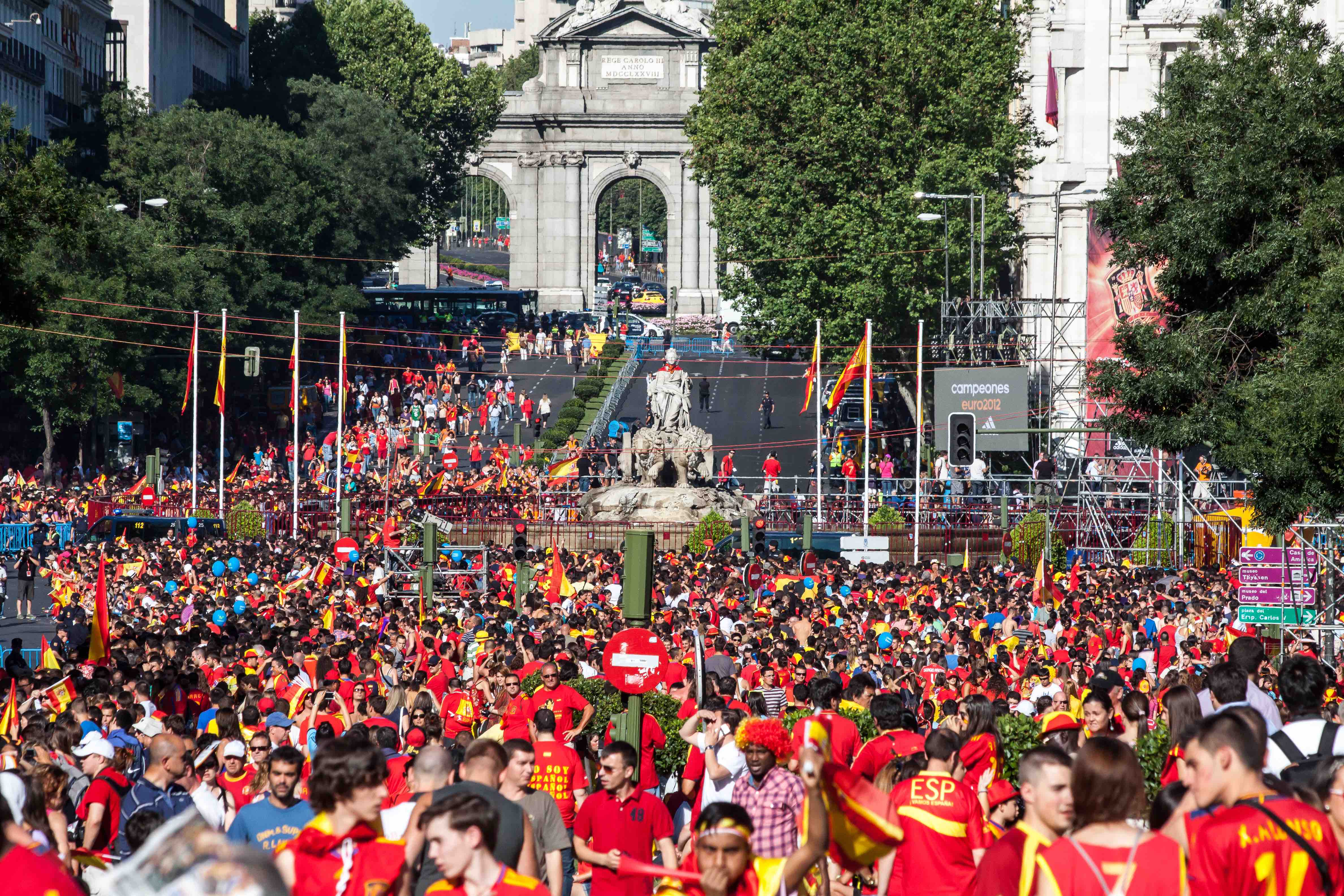 Excited Spanish fans celebrate in the Plaza de Cibeles in the victory of the Spanish football team.
