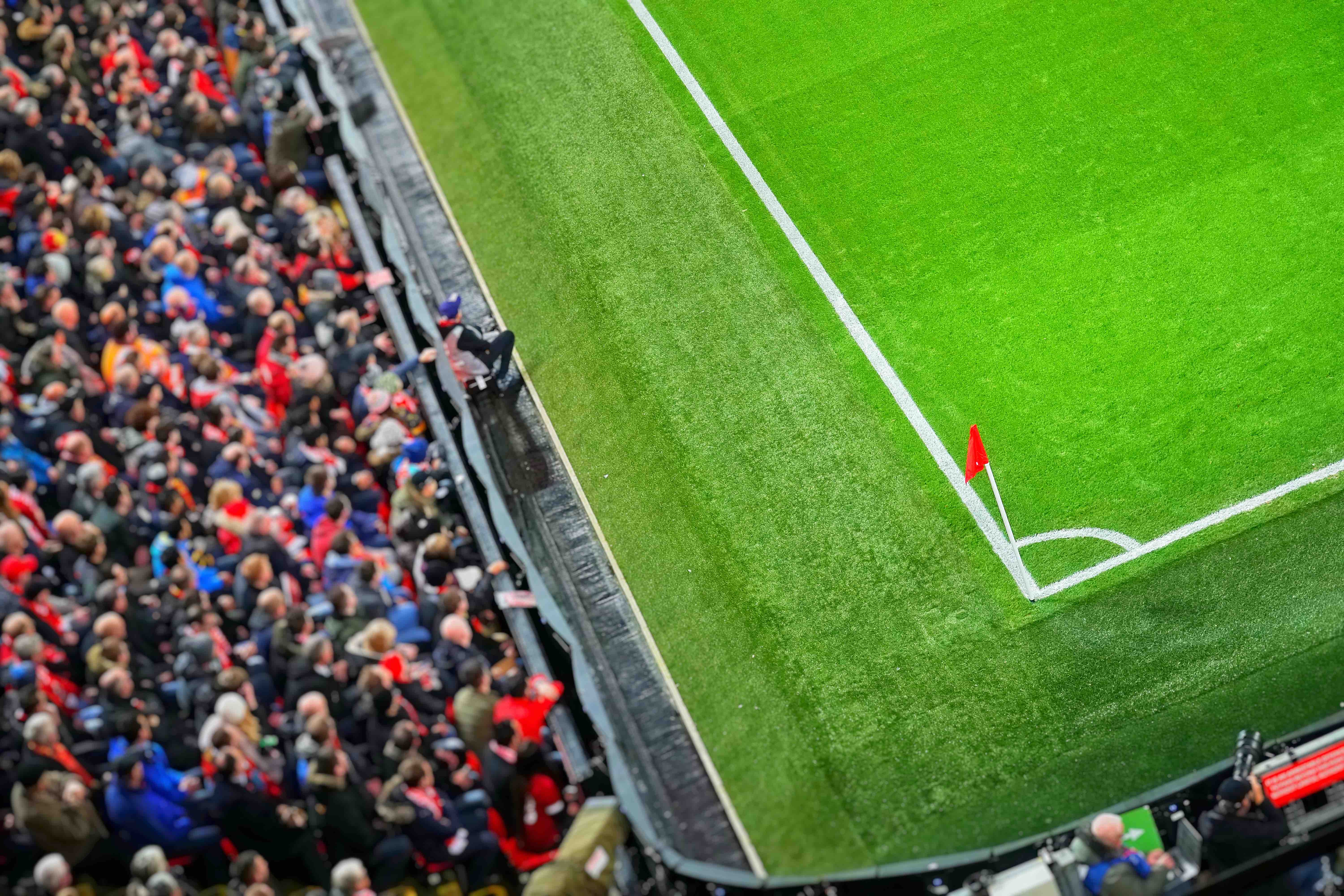 The buzz of the football players and fans on match day at Anfield, Liverpool.
