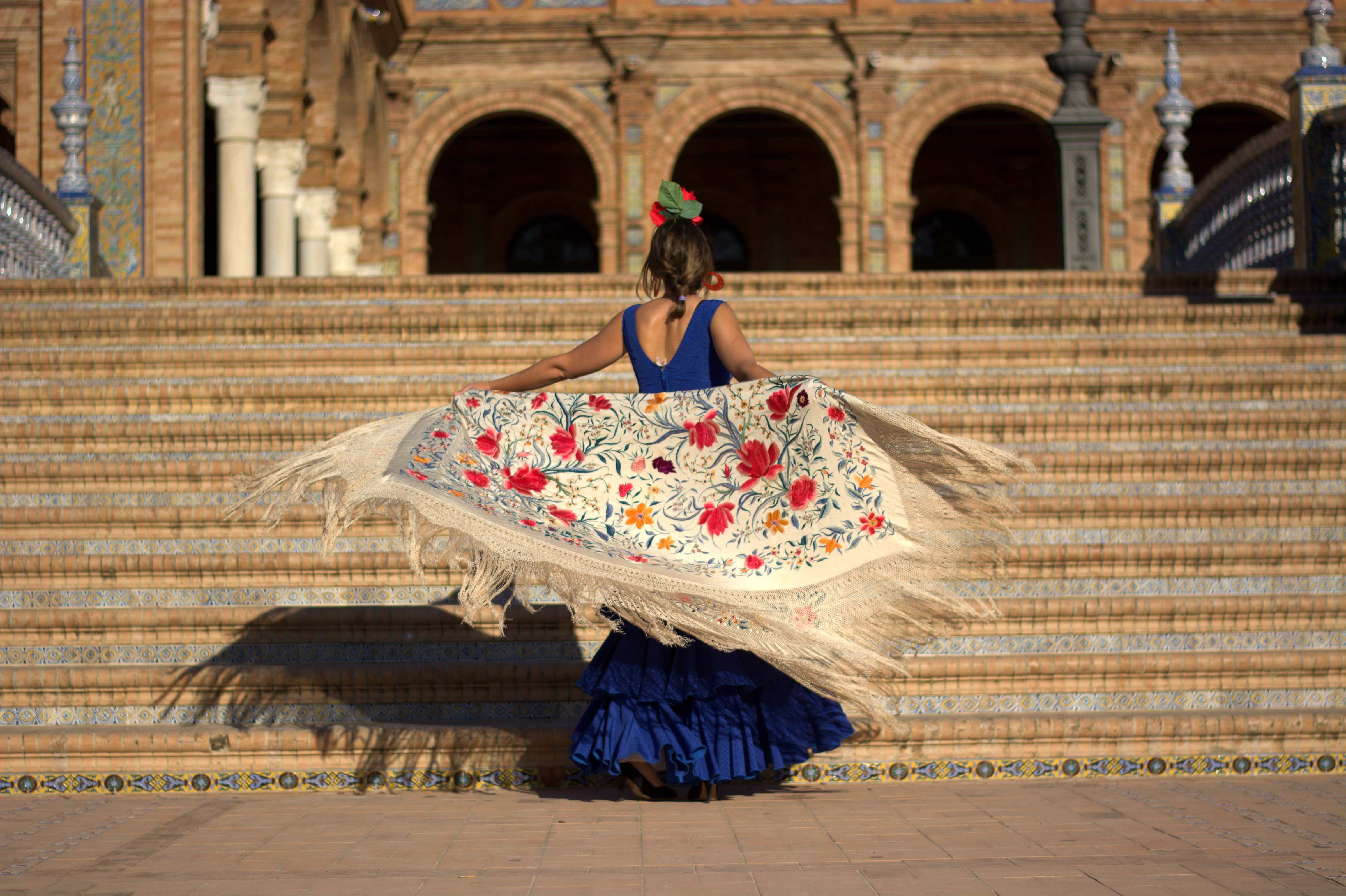 A flamenco dancer does her thing in the Plaza of Spain in Seville.