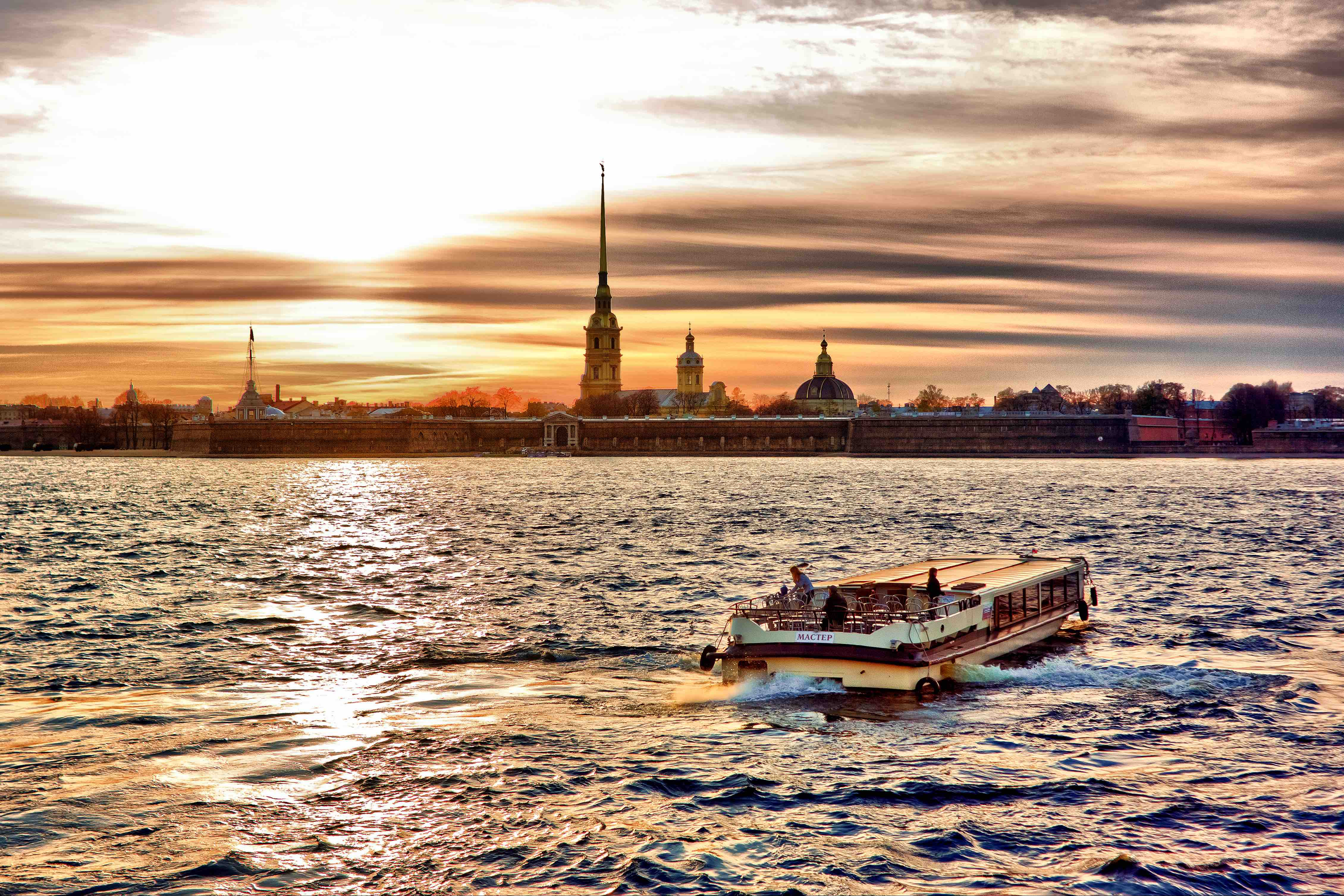 A gloriously golden sunset on the Neva River in Saint Petersburg.