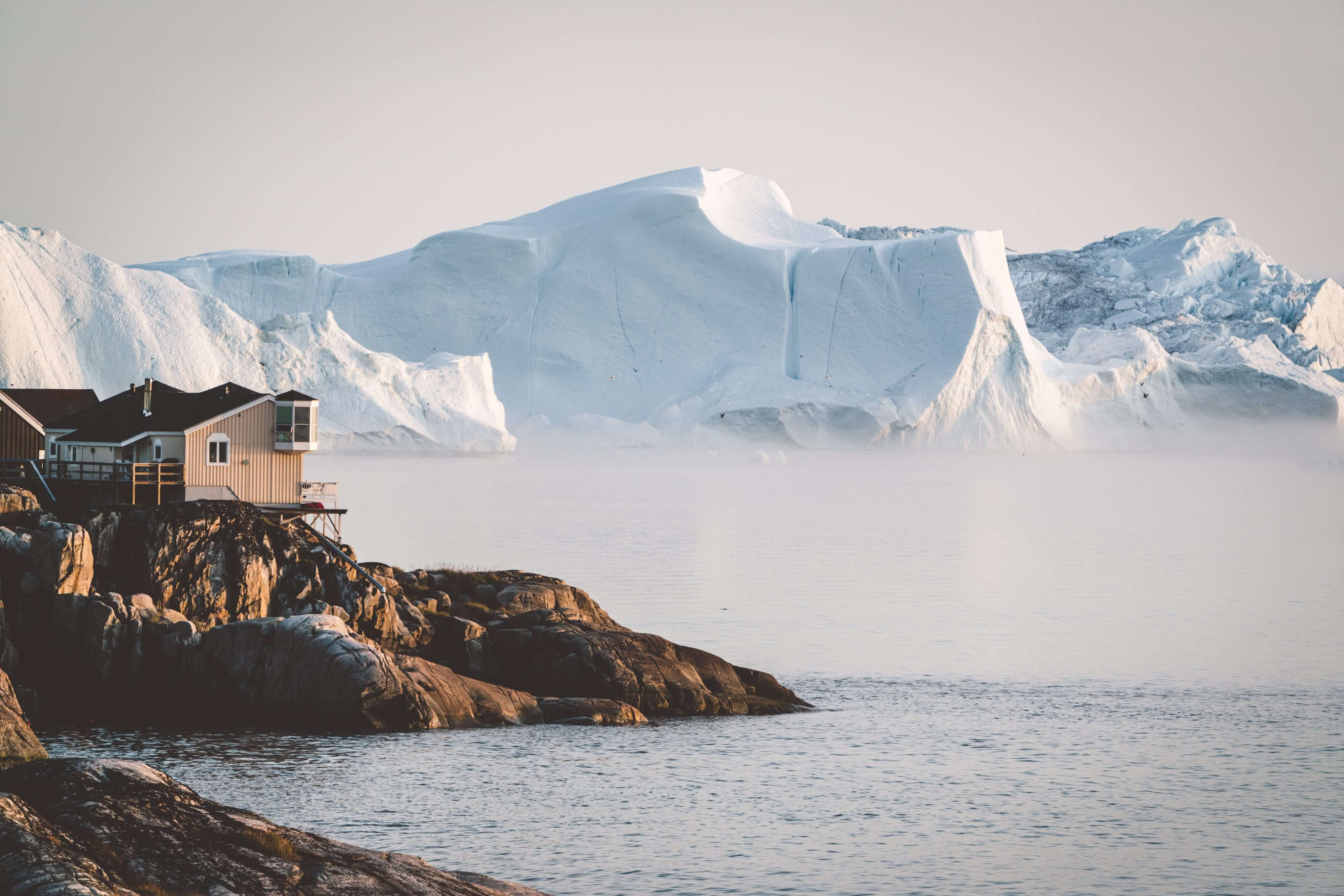 The incredible arctic city of Ilulissat, Greenland at sunrise.