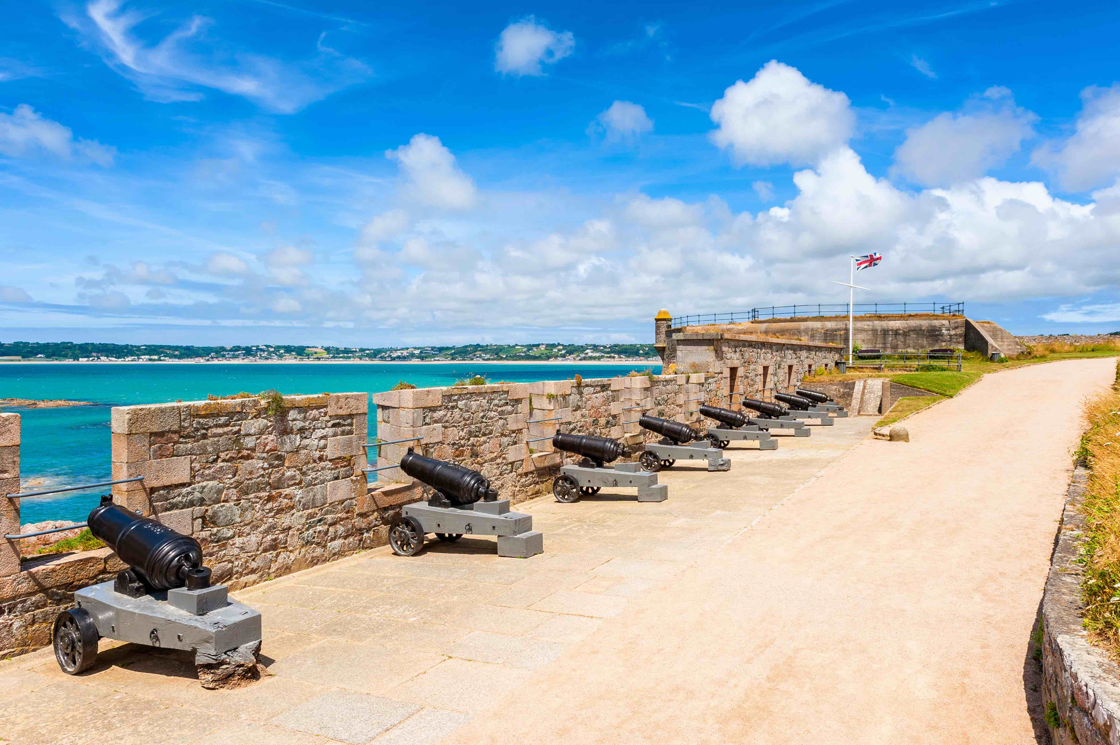 The historic cannons at Elizabeth Castle off the coast of St. Helier in Jersey.