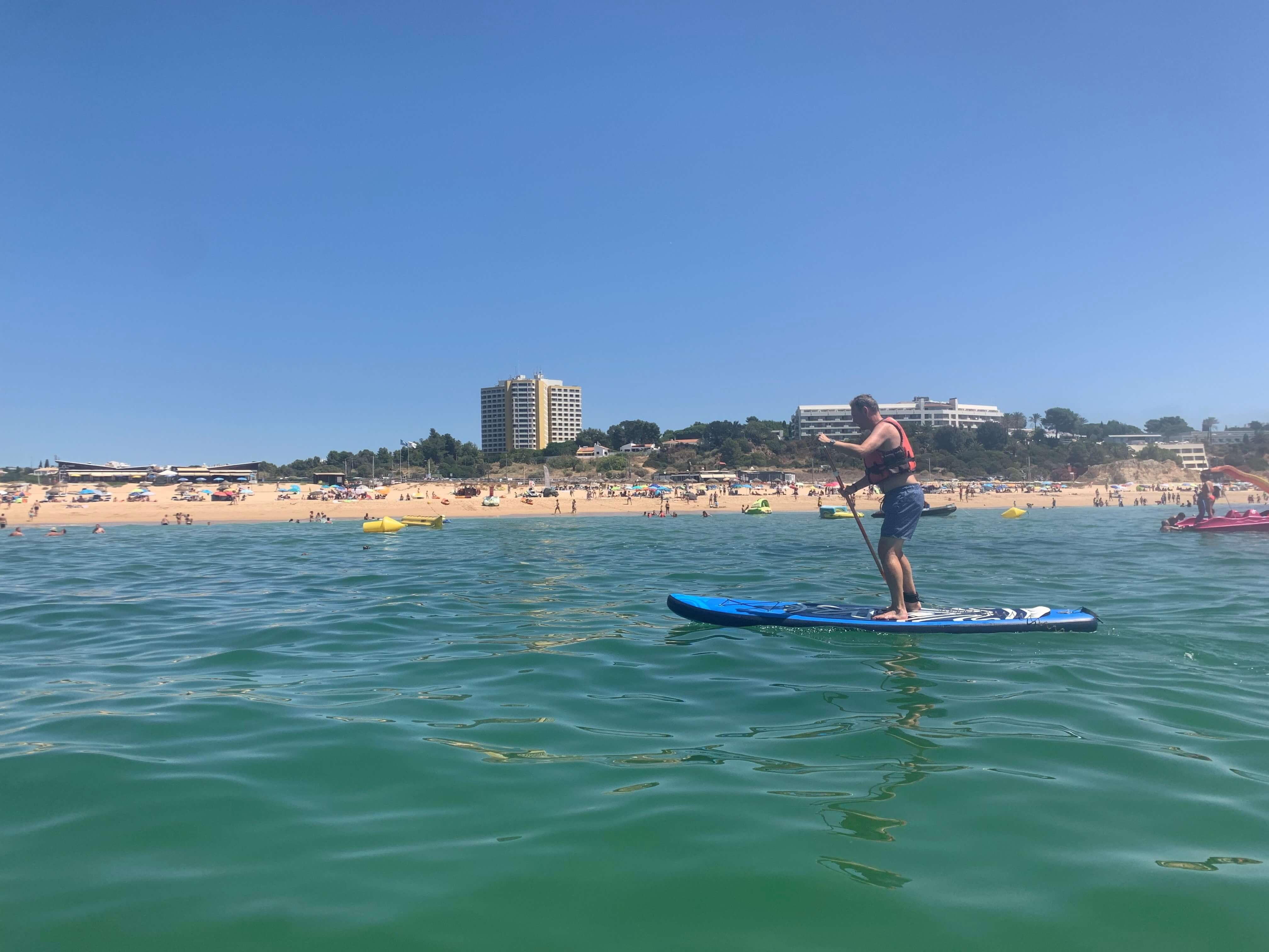 Niel paddleboarding along the sunny shores of the Algarve.